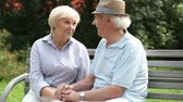 querido : Happy retired couple enjoying each other's company dating in the park