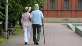 cana : Active retirees taking a walk in the summer park