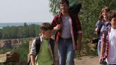 quatro : Family of four carrying backpacks enjoying their recreational weekend