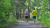 diariamente : Active couple starting their day with jogging to keep fit Vídeos