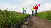 quatro pessoas : Group of cute kids with balloons being on their way to the imaginative destination Stock Footage