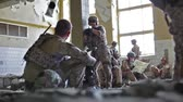 militar : Soldiers having a rest in an abandoned building