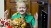 drůbež : Little girl being happy about dinner with a roasted chicken as a main dish