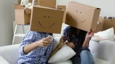 desenhado : Happy move-ins pillow fighting then taking picture of themselves in boxes with drawn smiles
