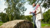 жена : Romantic retirees enjoying spending time together in the summer park