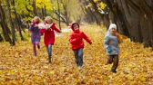 irmã : Cheerful children running energetically along the autumn park lane