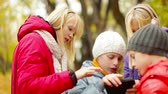 curiosidade : Close-up of smart kids being interested in a modern device