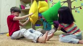 jardim de infância : Slow motion of a group of children having a pillow fight Stock Footage