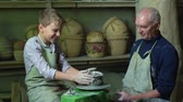 vnuk : Boy failing to make a clay vase on a pottery wheel