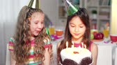 ocasião : Little cutie making a wish and blowing out candles, her friend applauding Vídeos