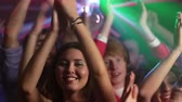 group : Excited nightclub audience clapping and jumping and dancing with energy