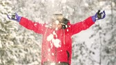 adorável : Slow-motion of a cheerful lad playing with snow