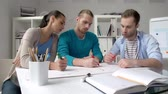marcador : Group of developers at the desk scheming and drawing