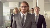 aeroporto : Slow motion of four business people approaching camera, everybody following speccy ginger-haired guy Vídeos