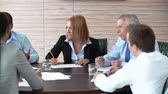 group : Pan of business people brainstorming at round table Stock Footage