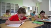 classmates : Whole class concentrated on writing control work