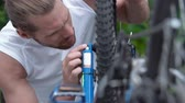 cog : Dolly of bicycle turned upside down and examined by its owner Stock Footage