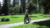 push : Cyclist stopping to check his smartphone inbox in park