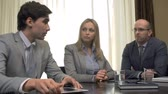 摘要 : Racking focus of two subordinates reporting to female boss at the meeting