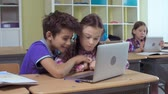 akademický : Pupils using information technology facilities at the lesson