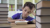comprehension : Close up of school boy reading to himself Stock Footage