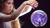 feiticeiro : Girl conjuring with magic ball and creating smoke