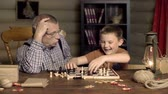 chess board : Impatient boy strewing chess pieces around unwilling to continue game with grandfather