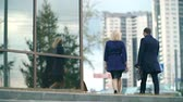 downtown : Businessman greeting his business partner at the office building