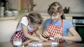 штифт : Two girls preparing bakery in the kitchen