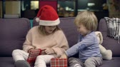 organizador : Girl presenting digital tablet for Christmas to her little brother