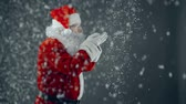 confete : Santa Claus blowing on his palms thus starting snowfall