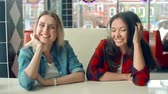 positividade : Girls looking at camera playfully like seeing handsome guys Stock Footage
