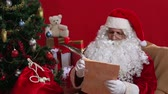 prezent : Santa reading a list of wishes and rejecting one