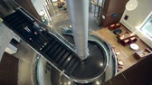 spiral : Direct from above view of two business partners going down the winding stairs Stock Footage