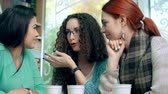 grupo de pessoas : Low angle close up of three girls talking and having coffee Stock Footage