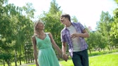 chůze : Slow motion of couple strolling along the lane and enjoying conversation