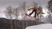 front view : Cool snowboarder performing japan air grab Stock Footage