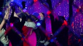 sedutor : Jolly crowd going all out dancing at nightclub Stock Footage