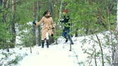 Валентин : Tilt down the winter forest with young adults playing tag