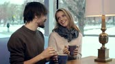 romantizm : Young couple drinking tea in cafe and cuddling joyously Stok Video