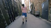 pontapé : Proud soccer player freestyling on the move along the street