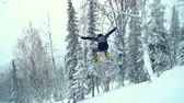 движение : Slow motion of snowboard rider jumping from the mountain top
