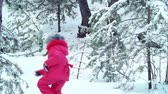 снежный : High angle view of two kids playing tag in winter park
