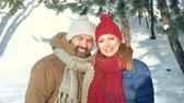 Валентин : Close up of man and woman posing for a photo in the winter park
