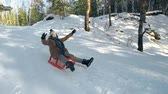 despreocupado : Tracking shot of little boy sleighing downhill with his hands up