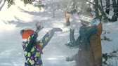 snowfall : Slow motion of kids tossing snow in the air Stock Footage
