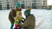 close up : Close up of mother supporting child skating and father hugging his daughter Stock Footage