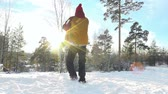игривый : Slow motion of man spinning his child around in the woods