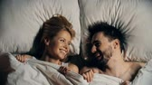 Валентин : Sweet couple hiding under the sheets and laughing