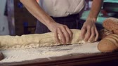 farinha : Mid-section of cropped unrecognizable chef kneading long piece of dough Stock Footage